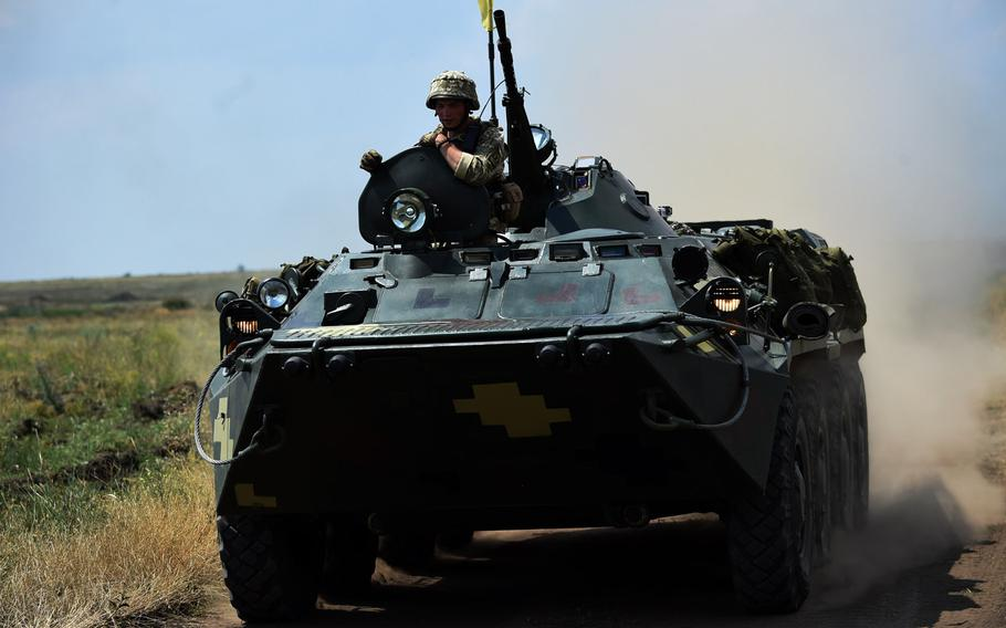 Ukrainian marines drive a BTR-4 armoured transporter during Exercise Sea Breeze, Thursday, July 12, 2018.
