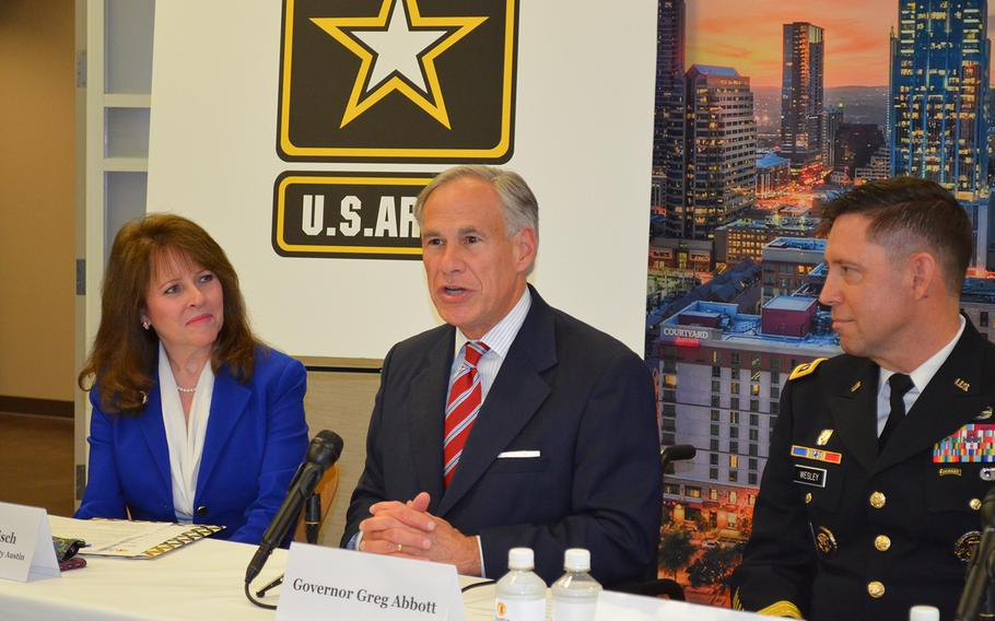 Texas Gov. Greg Abbott, center, speaks Friday during a news conference at the Greater Austin Chamber of Commerce to celebrate Austin as the home of Army Futures Command headquarters. On his right sits Charisse Bodisch, the chamber's senior vice president of economic development, and to his left sits Lt. Gen. Eric Wesley, integration management officer for the Army Futures Command.