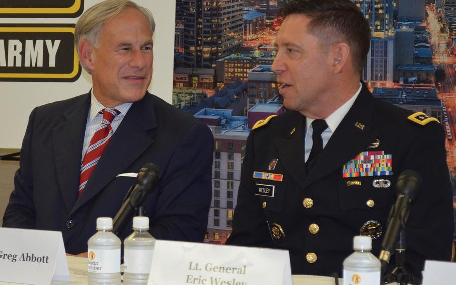 Lt. Gen. Eric Wesley, right, integration management officer for the Army Futures Command, speaks Friday during a news conference at the Greater Austin Chamber of Commerce to celebrate Austin as the home of Army Futures Command headquarters. To his right sits Texas Gov. Greg Abbott.