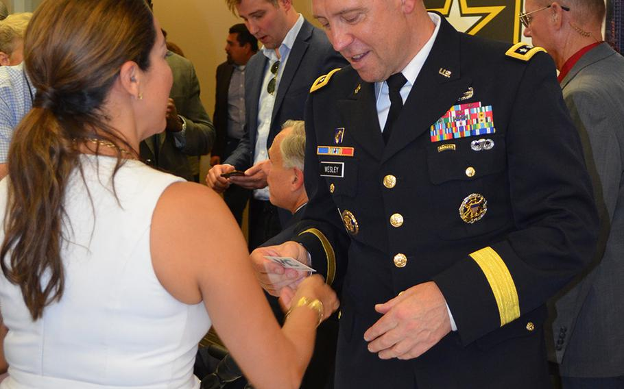 Lt. Gen. Eric Wesley, integration management officer for the Army Futures Command, greets members of the Austin business community Friday following a Greater Austin Chamber of Commerce news conference. The event celebrated the announcement of Austin as home to the new Army Futures Command headquarters.
