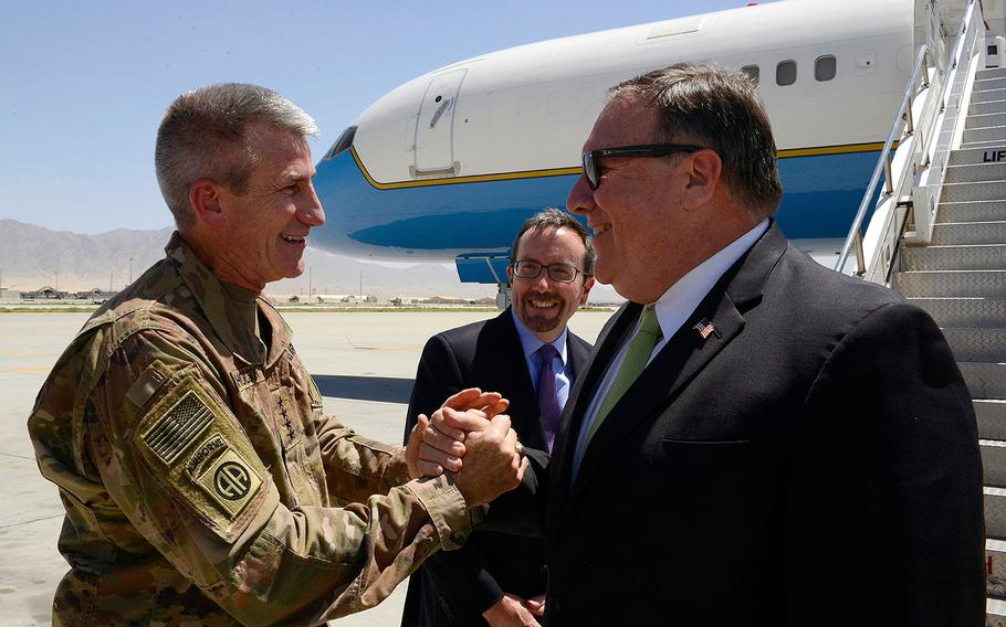 U.S. Army Gen. John Nicholson, Resolute Support commander, and John Bass, U.S. Ambassador to Afghanistan, greet U.S. Secretary of State Mike Pompeo during his arrival at Bagram Airfield, Afghanistan, July 9, 2018.