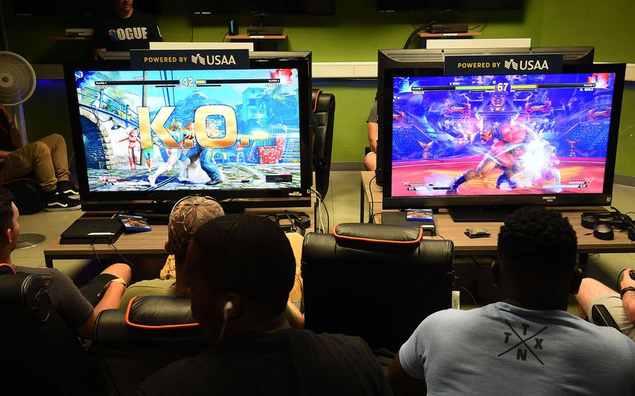 Soldiers play Street Fighter V at an E-Game tournament at Grafenwoehr, Germany, Saturday, July 28, 2018.