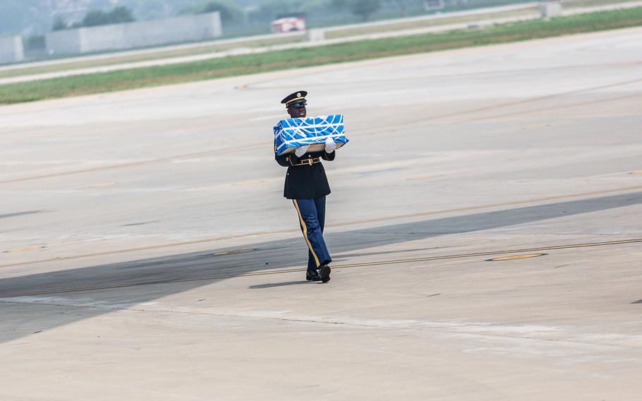 Staff Sgt. Jamil Green carries the final case of remains at Osan Air Base, South Korea, Friday, July 27, 2018.