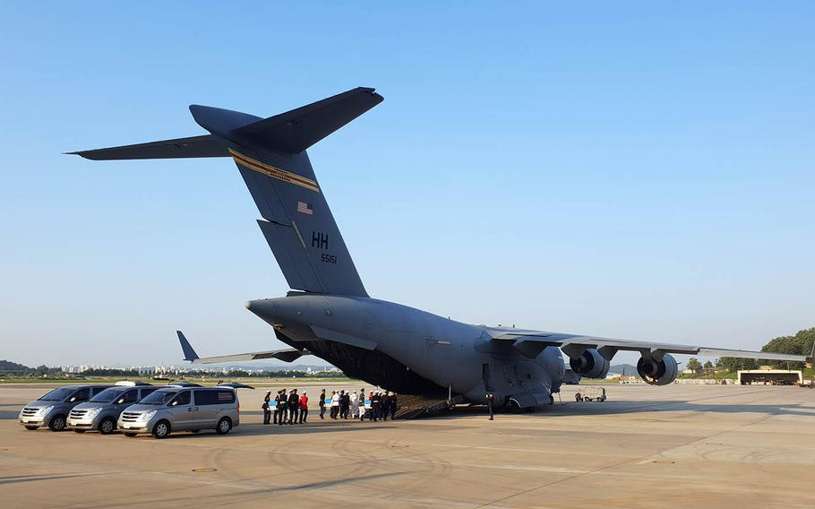 Remains recently handed over by North Korea are loaded onto an Air Force transport plane at Osan Air Base, South Korea, for their trip to Hawaii, Wednesday, Aug. 1, 2018.