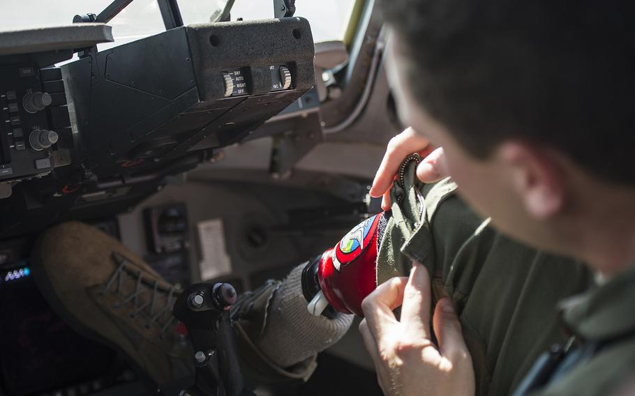U.S. Air Force Capt.Ryan McGuire, C-17 Globemaster III pilot with the 535th Airlift Squadron, adjusts his prosthetic before a training flight, Sep 12, 2017 on Joint Base Pearl Harbor-Hickam. Servicemembers wounded in combat who are unable to deploy will not face mandatory separation under a new Defense Department Defense policy.