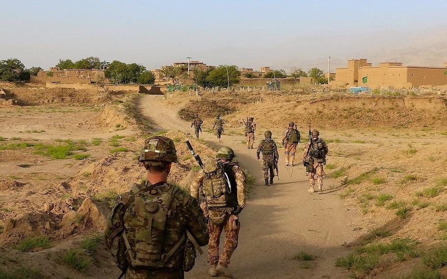 Raider soldiers from 4th Battalion, 9th Infantry Regiment, 1st Stryker Brigade Combat Team, 4th Infantry Division and soldiers from the Czech Army conduct a patrol in Eastern Afghanistan on July 25, 2018. Three Czech soldiers were killed by a suicide bomber in Afghanistan on Sunday, Aug. 8, 2015.    (U.S. Army photo by Staff Sgt. Lerone Simmons)