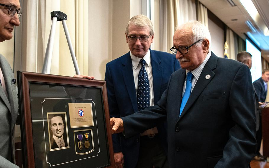 Air Force veteran Joseph M. Hish Jr., 90, holds back tears as he reaches out to touch a special gift he received during a ceremony in Washington D.C. on Purple Heart Day on Tuesday, Aug. 7, 2018. The glass-encased framed board contained military medals and paraphernalia belonging to Hish's father, World War I veteran Pfc. Joseph Mark Hish.