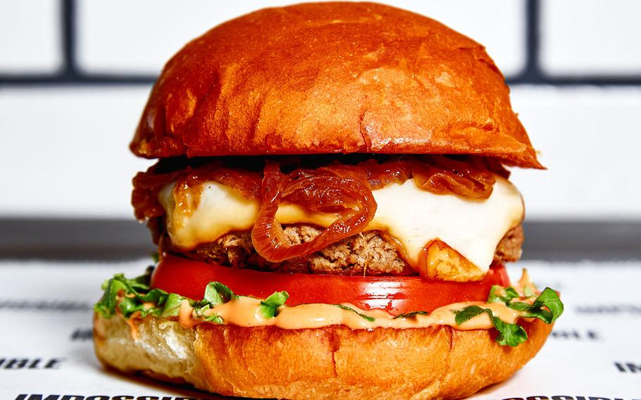 Wahlburgers — the fast-casual restaurant founded by executive chef Paul Wahlberg and brothers Mark and Donnie Wahlberg — will open its first location on a military installation at Joint Base Lewis-McChord in 2020. Seen here is the Impossible Burger.