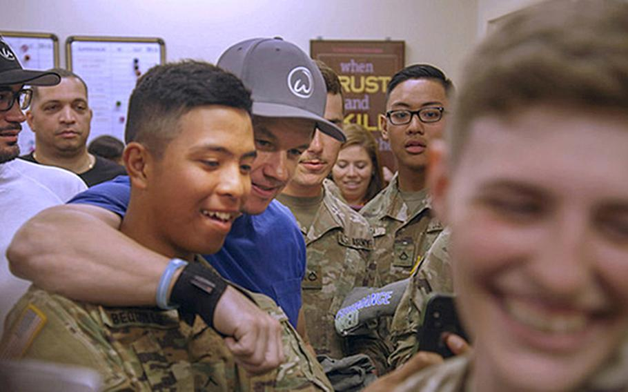 Through an agreement with the Army and Air Force Exchange Service, Wahlburgers will open its first location on a military installation in the spring of 2020 at Joint Base Lewis-McChord. In this photo, Mark Wahlberg meets with troops at the Fort Benning Exchange in May to thank them for their service.
