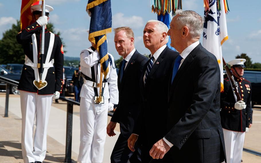 Vice President Mike Pence, center, is greeted by Deputy Secretary of Defense Pat Shanahan, left, and Secretary of Defense Jim Mattis before speaking at an event on the creation of a United States Space Force, Thursday, Aug. 9, 2018 at the Pentagon.