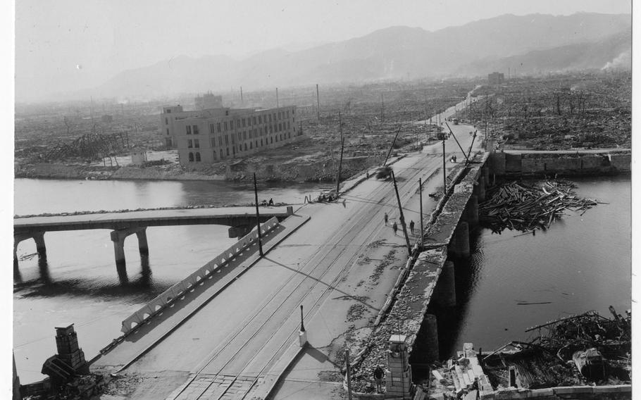 Aioi Bridge, which was a target for the atomic bomb dropped on Hiroshima on August 6, 1945, is shown damaged after the bombing. The bridge was about 250 meters from the center of the explosion. This photograph was among 36 photographs donated to the Hiroshima Peace Museum by Gayle Yoshikawa.