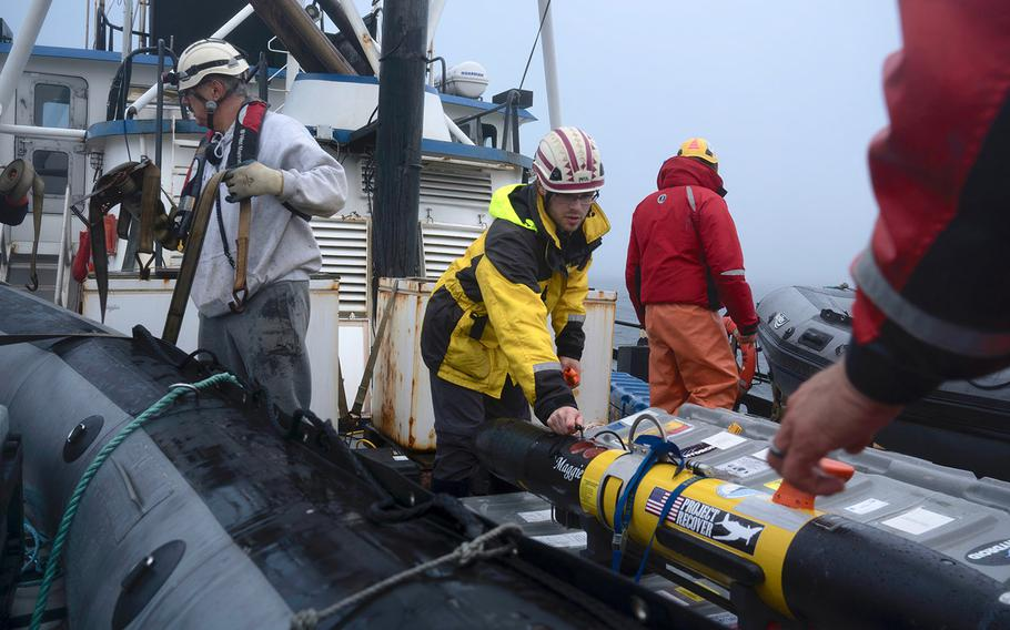 """Eric Gallimore, a doctoral candidate at Scripps Institution of Oceanography at UC San Diego, secures """"Maggie,"""" anunderwater vehicle used to help locate the missing stern of the USS Abner Read onJuly 17.The stern sank Aug. 18, 1943 at the height of World War II after being blown off by a Japanese mine."""