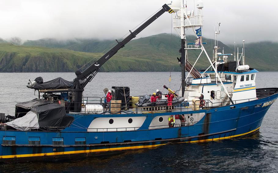 Members of Project Recoverlaunch one of fourunderwater vehicles used to search the seafloor near the Aleutian Islands for wreckage from World War II. Researchers were aboard Norseman II, a research vessel, in July.
