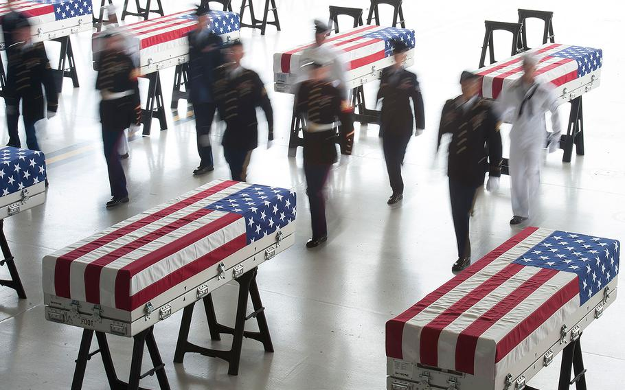 An honor guard detail of U.S. Indo-Pacific Command (INDOPACOM) personnel conducts an honorable carry ceremony at Joint Base Pearl Harbor-Hickam (JBPH-H), Hawaii, Aug. 1, 2018. The 55 flag-draped transfer cases contain what are believed to be the remains of American servicemembers killed in the Korean War.