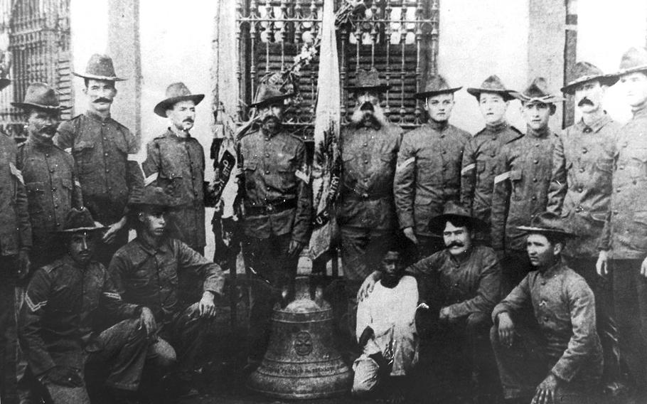 Soldiers from the 9th Infantry Regiment pose with one of three Balangiga bells in the Philippines in 1902 in this photo, displayed in the 2nd Infantry Division museum. Legislators from Wyoming oppose the Pentagon's planned return of the bells to the Philippines.