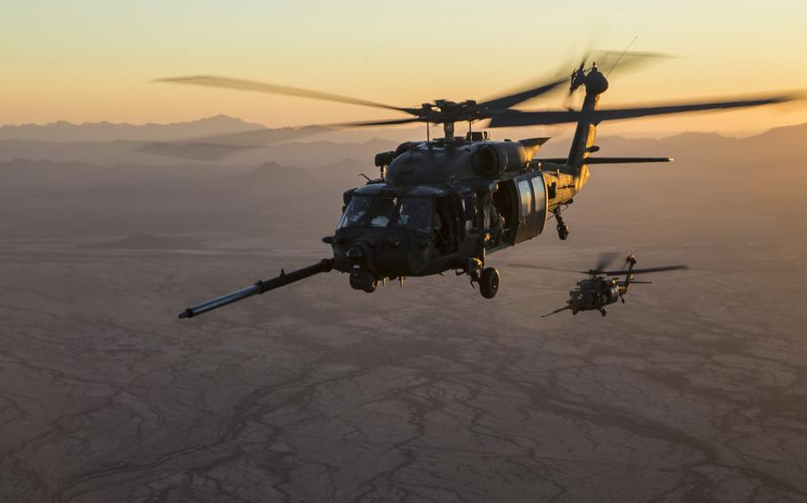 A pair of U.S. Army MH-60M Blackhawks  prepare to conduct an aerial refueling exercise over Yuma, Ariz., Oct. 6, 2017. A coalition servicemember was killed and several were wounded after a helicopter crashed in Iraq late Sunday, military officials said. According to Newsweek, it was a MH-60 Black Hawk.