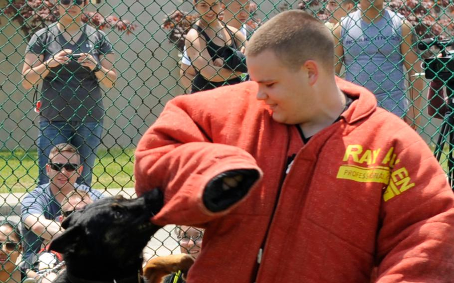 Robert Kelgard takes part in a military working dog demonstration during a sports day event for the children of a South Korean orphanage at Kunsan Air Base in 2013. The former U.S. senior airman has been jailed for sexually abusing orphans and possessing child pornography in a 2016 case that prompted new community guidelines at the base.