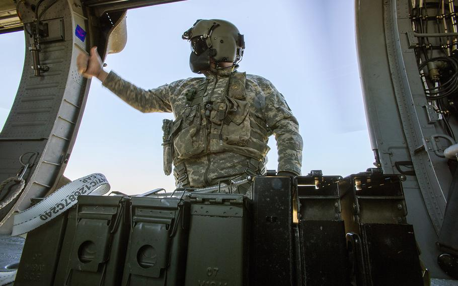 Staff Sgt. Paul Cimino, right, a master gunner with the 1-150th Assault Helicopter Battalion, New Jersey Army National Guard, gives the thumbs-up after securing M240B machine gun ammunition during an aerial gunnery training mission at the 177th Fighter Wing's Detachment 1, Warren Grove Gunnery Range, N.J., April 15, 2016.