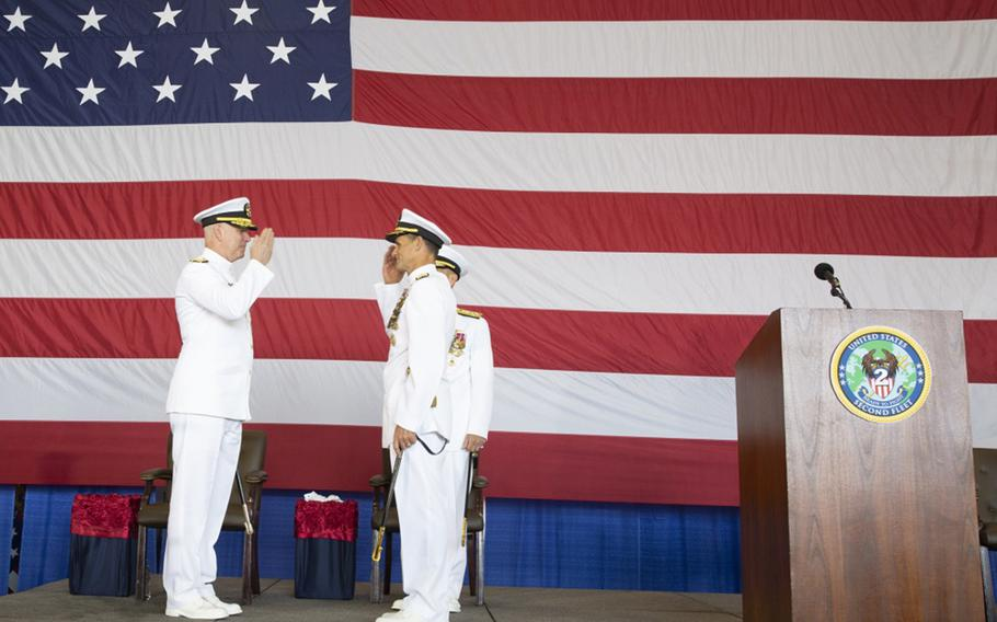 """Adm. Chris Grady, commander, U.S. Fleet Forces Command, left, returns Vice Adm. Andrew """"Woody"""" Lewis' salute as Lewis assumes command of U.S. 2nd Fleet aboard the nuclear aircraft carrier USS George H.W. Bush. U.S. 2nd Fleet will exercise operational and administrative authorities over assigned ships, aircraft and landing forces on the East Coast and North Atlantic."""