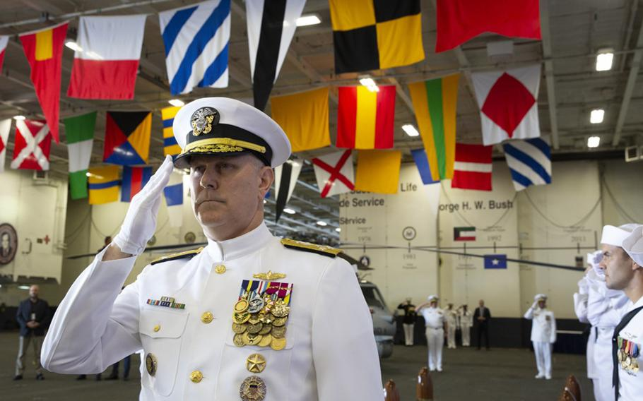 Adm. Chris Grady, commander, U.S. Fleet Forces Command, salutes the sideboys as he arrives to the U.S. 2nd Fleet establishment ceremony aboard the nuclear aircraft carrier USS George H.W. Bush. U.S. 2nd Fleet will exercise operational and administrative authorities over assigned ships, aircraft and landing forces on the East Coast and North Atlantic.