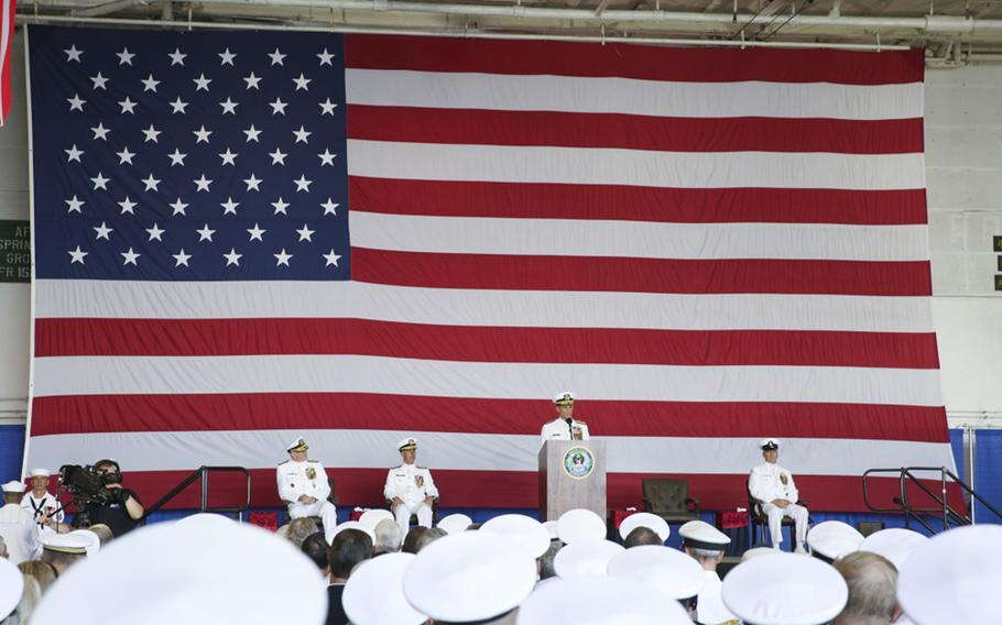 """Vice Adm. Andrew """"Woody"""" Lewis, center, address guests aboard the nuclear aircraft carrier USS George H.W. Bush as he assumes command of U.S. 2nd Fleet. U.S. 2nd Fleet will exercise operational and administrative authorities over assigned ships, aircraft and landing forces on the East Coast and North Atlantic."""