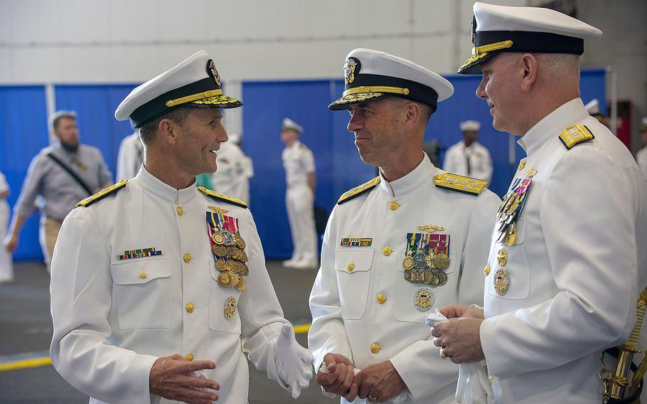 """Commander, U.S. 2nd Fleet Vice Adm. Andrew """"Woody"""" Lewis talks with Chief of Naval Operations Adm. John Richardson and Commander, U.S. Fleet Forces Adm. Chris Grady, following the 2nd Fleet Establishment Ceremony aboard the nuclear aircraft carrier USS George H.W. Bush at Naval Station Norfolk on Aug. 24, 2018 in Virginia."""