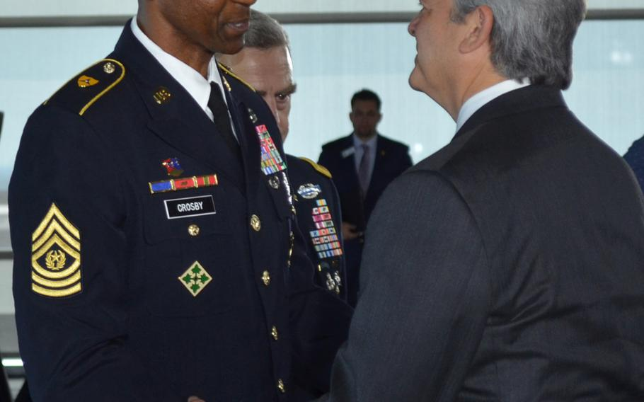 Command Sgt. Maj. Michael Crosby, the top noncommissioned officer of the Army Futures Command, shakes hands with Austin Mayor Steve Adler following the Army Futures Command activation ceremony in Austin, Texas, on Friday.