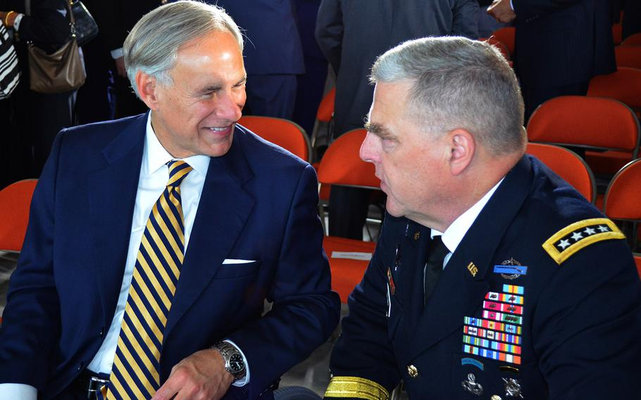 Texas Gov. Greg Abbott and Army Chief of Staff Gen. Mark Milley talk following the Army Futures Command activation ceremony in Austin, Texas, on Friday.