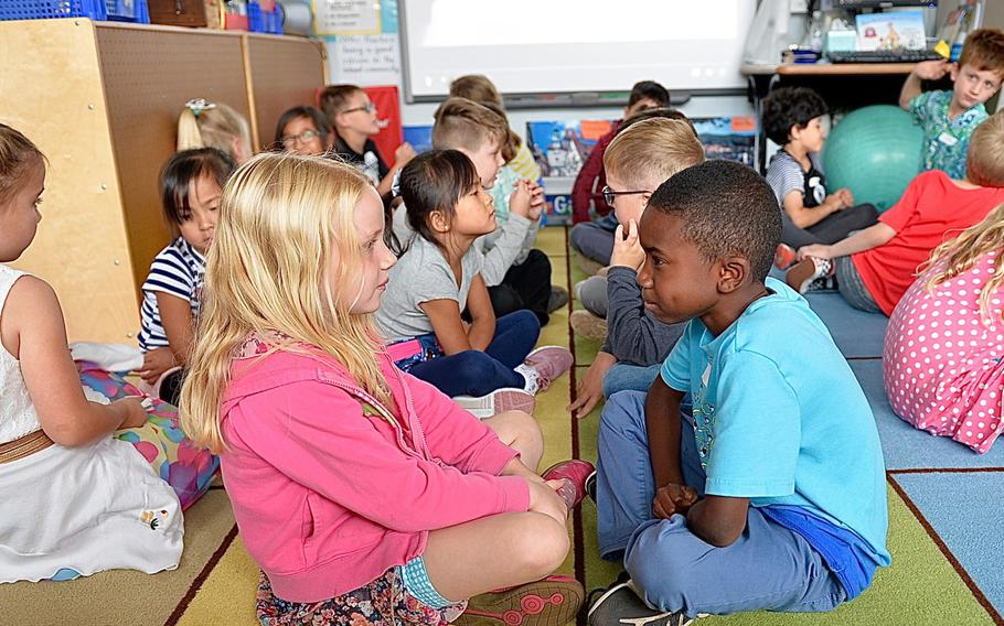 """Conversation partners Victoria Hutchison and Jude Holmes talk about """"First Day Jitters,"""" a book by Julia Danneberg about being nervous the first day of school, Landstuhl Elementary/Middle School, Germany, Monday, Aug. 27, 2018."""