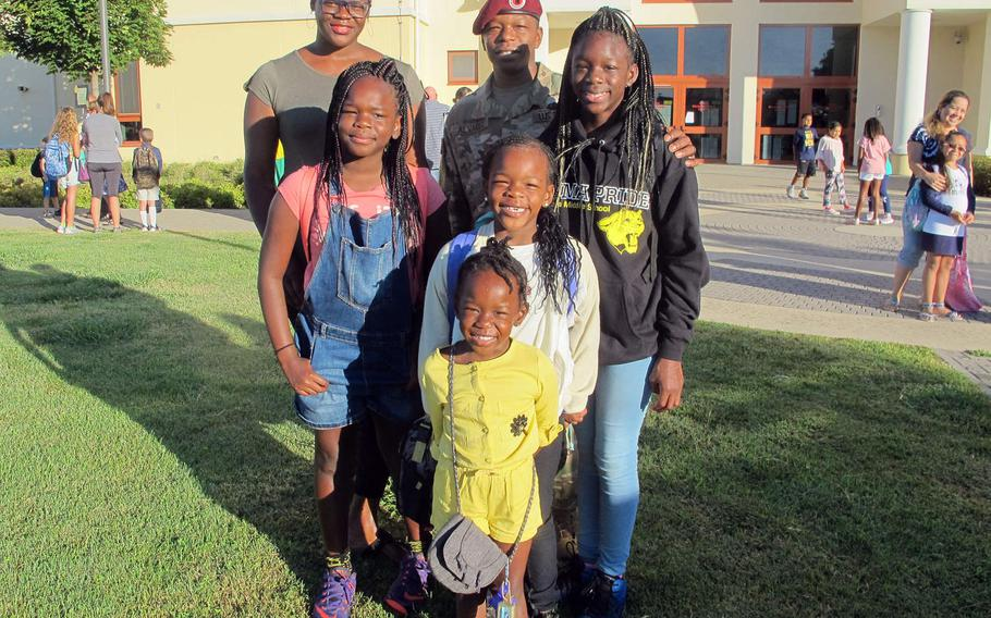 The Alvarez family poses in front of Vicenza Elementary on the first day of school. The family arrived recently from Washington state. ''It's off to a great start,'' said Kaitlyn, 9. ''I'm nervous,'' said Nysa, 11. Also pictured are Madisyn, 6, Lauryn, 4 and parents Mercy and Mario.
