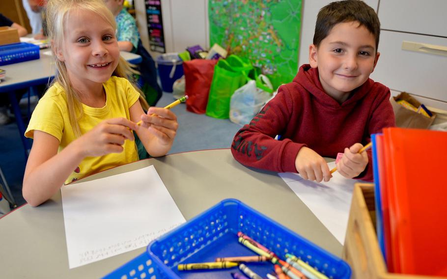 Mary Kate Feldt and Rylan Gonzalez, both 7, sit next to each other in a German immersion class at Landstuhl Elementary/Middle School, Germany, Monday, Aug. 27, 2018.