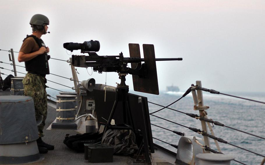 Petty Officer 3rd Class Calvin Day stands watch as the guided-missile destroyer USS The Sullivans conducts a routine transit through the Strait of Hormuz, Aug. 5, 2018.