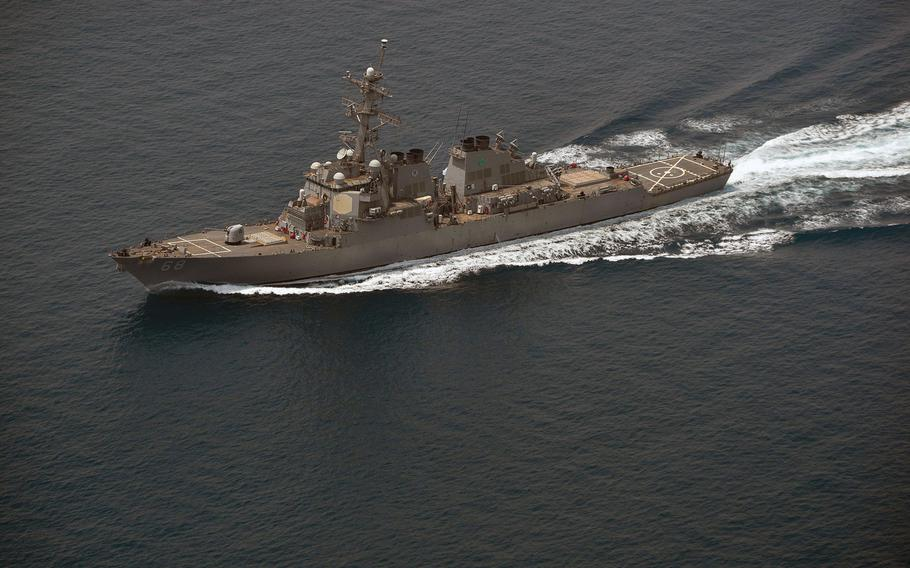 The guided-missile destroyer USS The Sullivans conducts a routine transit through the Strait of Hormuz, July 15, 2018. The U.S. said it will continue to maneuver in the Persian Gulf, rejecting a claim by a top Iranian general that his ships were in full control of the strategic waterway and that American warships have no place in the region.
