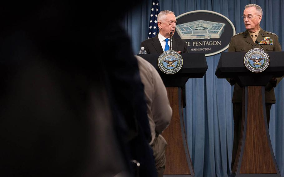 Defense Secretary Jim Mattis and Marine Gen. Joseph Dunford, the chairman of the Joint Chiefs of Staff, speak during a press conference Tuesday, Aug. 28, 2018 at the Pentagon.