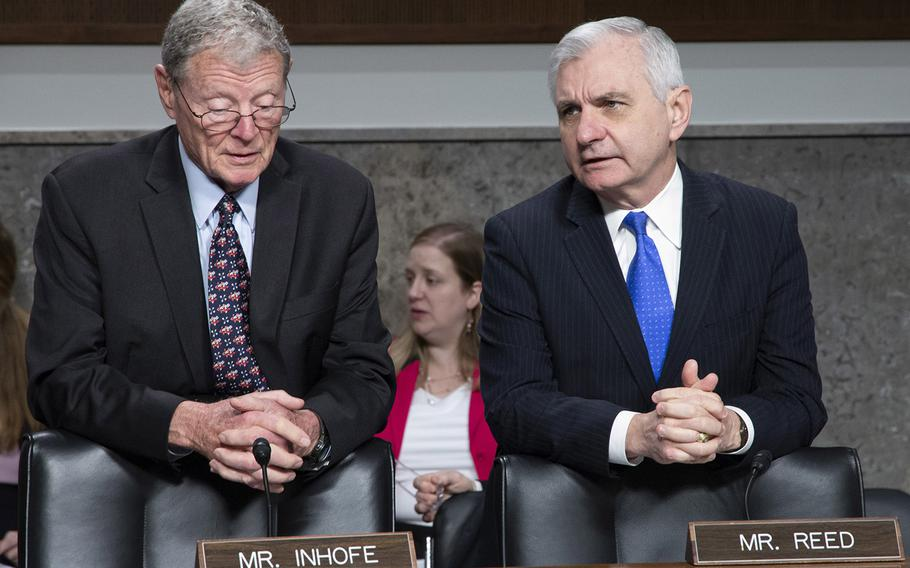 Sen. James Inhofe, R-Okla., left, and Sen. Jack Reed, D-R.I., talk before a Senate Armed Services Committee hearing in March, 2018.