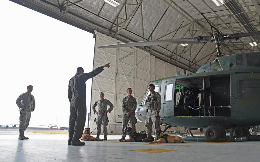 The 36th Rescue Squadron taught 92nd Security Forces Squadron military working dog handlers how to load and unload their canines, how to safely fly with a dog, and basic egress training in case of an emergencies.