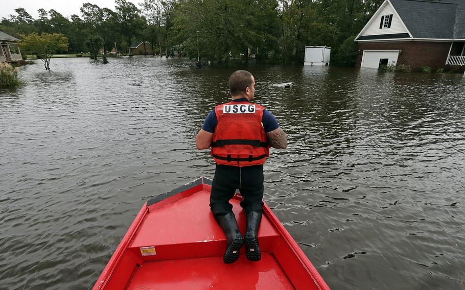 Petty Officer 2nd Class David Kelley patrols a flooded neighborhood in Lumberton, N.C., Sunday, Sept. 16, 2018, following flooding from Hurricane Florence.