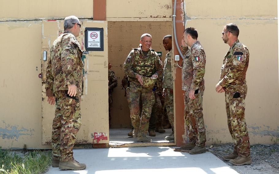 Italian Maj. Gen. Antonio Bettelli is the first person to process through and leave from the new passenger terminal at Resolute Support headquarters  in Kabul, Afghanistan, June 3, 2018.