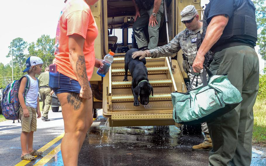 U.S. Air Force Security Forces Airmen assigned to the South Carolina Air National Guard, 169th Fighter Wing, assist the Florence County, S.C., Sheriff's Department with evacuation efforts in Florence, S.C., Sept. 17, 2018.