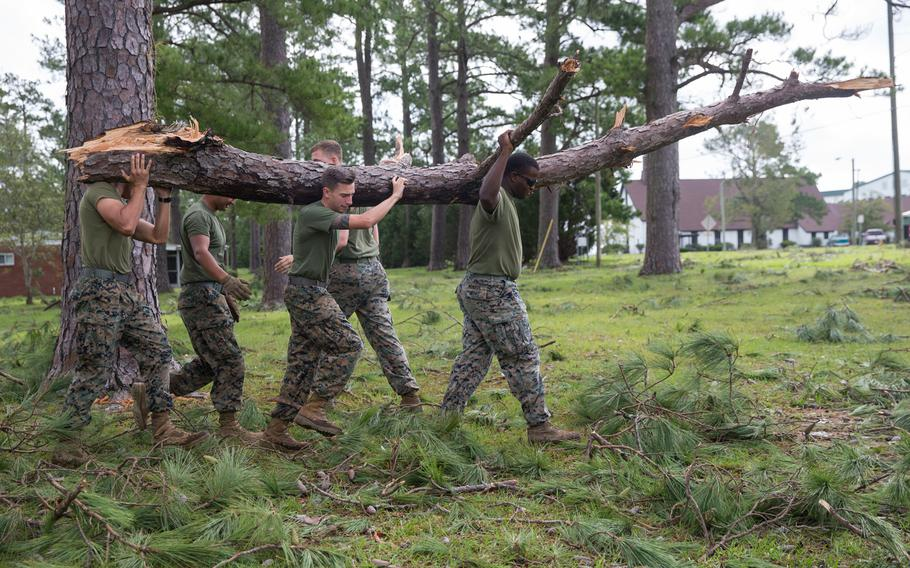 Marines with Marine Corps Air Station New River conduct a clean up effort after Hurricane Florence at McCutcheon Manor on MCAS New River, N.C., Sept. 17, 2018.