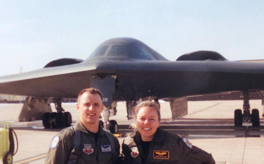 Then-Capts. John and Jennifer Avery smile for a photo in front of the B-2 Spirit at Whiteman Air Force Base, Mo.