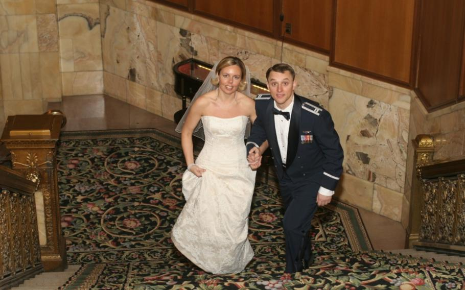 U.S. Air Force B-2 Spirit pilots John and Jennifer Avery smile for a photo on their wedding day Feb. 5, 2005.