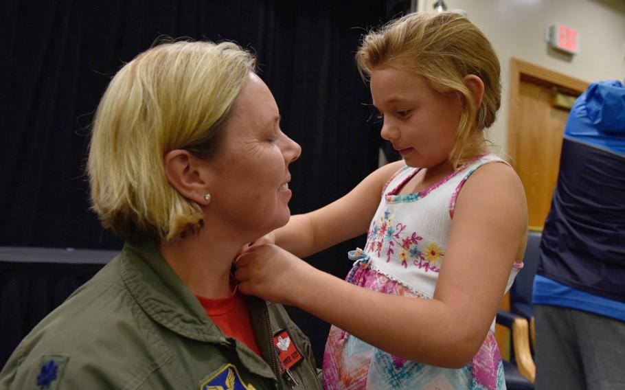 U.S. Air Force Lt. Col. Jennifer Avery receives her retirement pin from her daughter Elizabeth during a retirement ceremony Sept. 7, 2018, at Whiteman Air Force Base, Mo.