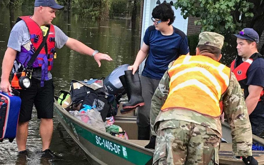 A soldier with the South Carolina Army National Guard assists Conway Fire Search and Rescue teams with rescue efforts in Conway, S.C., in the aftermath of Hurricane Florence, Sept. 17, 2018.
