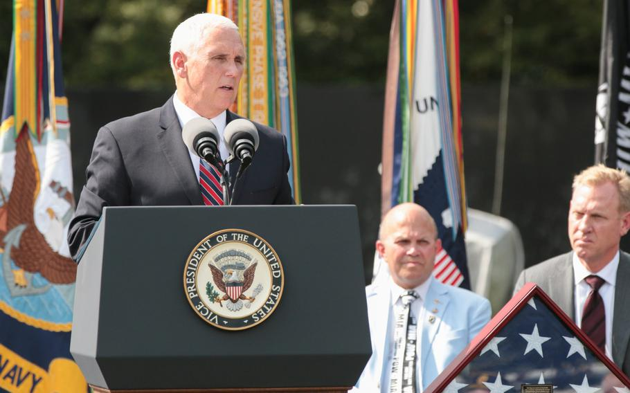 Vice President Mike Pence speaks in front of the Korean War Memorial in Washington, D.C., on Thursday, Sept. 20, 2018. Behind Pence sits a flag that was used in the transfer of remains ceremony that saw the remains of 55 American fighters killed in the Korean War returned to the U.S.