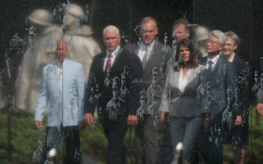 Vice President Mike Pence and Second Lady Karen Pence's reflection can be seen in the Korean War Memorial in Washington, D.C., on Thursday, Sept. 20, 2018.
