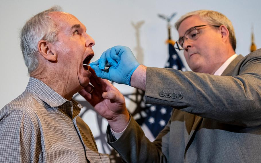 Department of Defense DNA Operations Director Timothy McMahon swabs the inside cheeks of Larry McDaniel, the son of Army Master Sgt. Charles H. McDaniel, who was listed as missing in action during the Korean War in 1950. President Donald Trump announced Thursday, Sept. 20, 2018, that the remains of Master Sgt. McDaniel and a private first class from North Carolina were included in the 55 cases of remains of missing Korean War veterans turned over in July by North Korea.