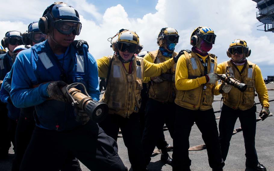 Sailors combat a simulated aircraft fire as part of a mass casualty drill on the flight deck of the Navy's forward-deployed aircraft carrier USS Ronald Reagan (CVN 76) during Valiant Shield 2018. The biennial, U.S. only, field-training exercise focuses on integration of joint training among the U.S. Navy, Air Force and Marine Corps. This is the seventh exercise in the Valiant Shield series that began in 2006.