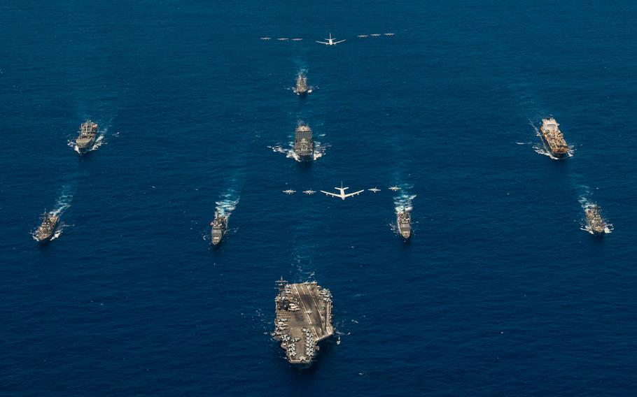 USS Ronald Reagan (CVN 76) leads a formation of Carrier Strike Group Five ships as U.S. Air Force B-52 Stratofortress aircrafts and U.S. Navy F/A-18s pass overhead for a photo exercise during Valiant Shield 2018. The biennial, U.S. only, field-training exercise focuses on integration of joint training among the U.S. Navy, Air Force and Marine Corps. This is the seventh exercise in the Valiant Shield series that began in 2006.