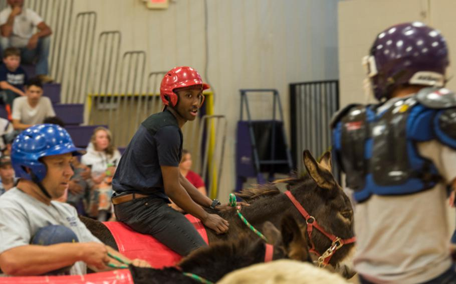 Khalil Davis, space vehicle operator with the 1st Space Operations Squadron, keeps his eye on his opponents during the Ellicott High School donkey basketball mini-tournament on Sept. 20, 2018.
